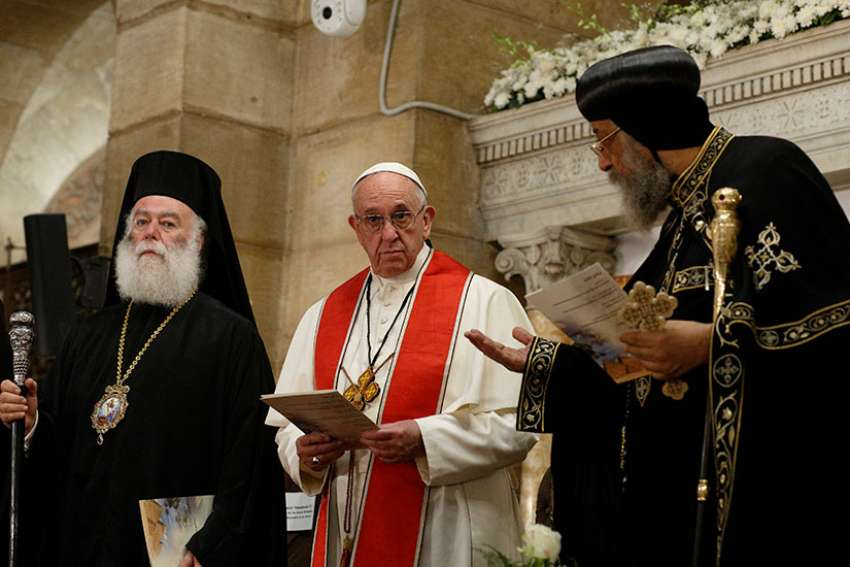 Pope Francis and Coptic Orthodox Pope Tawadros II, right, attend an ecumenical prayer service at the Chruch of St. Peter in Cairo April 28. The pope was making a two-day visit to Egypt.