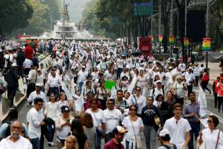 People arrive to participate in a march against the legalization of same-sex marriage Sept. 24 in Mexico City.
