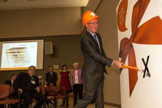 Providence Healthcare Foundation board member Andrew Branion symbolically inaugurates the renovation to Providence Healthcare's palliative care wing April 2.