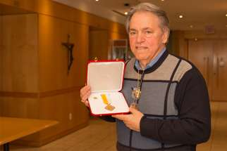Mario Biscardi with his Cross Pro Ecclesia et Pontifice medal.
