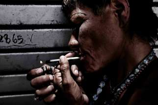 A drug addict smokes drugs in the city of San Jose, Costa Rica.
