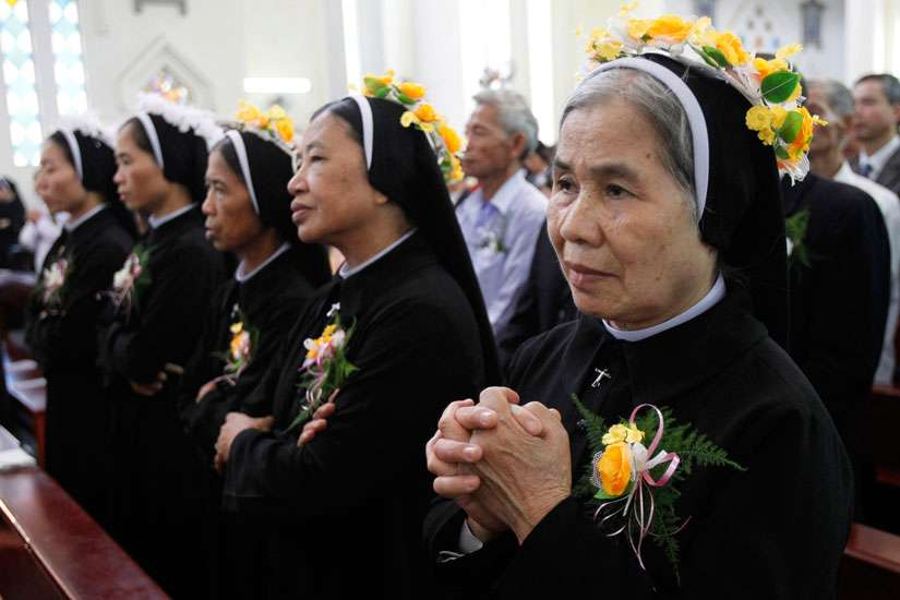Nuns attend a Mass for the profession of vows for the Lovers of the Holy Cross of Hung Hoa Sisters in Son Tay, Vietnam, Oct. 29, 2011.
