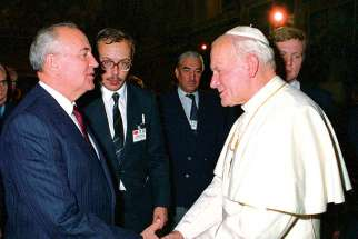Pope John Paul II greets Soviet President Mikhail Gorbachev at the Vatican in this Dec. 1, 1989, file photo.