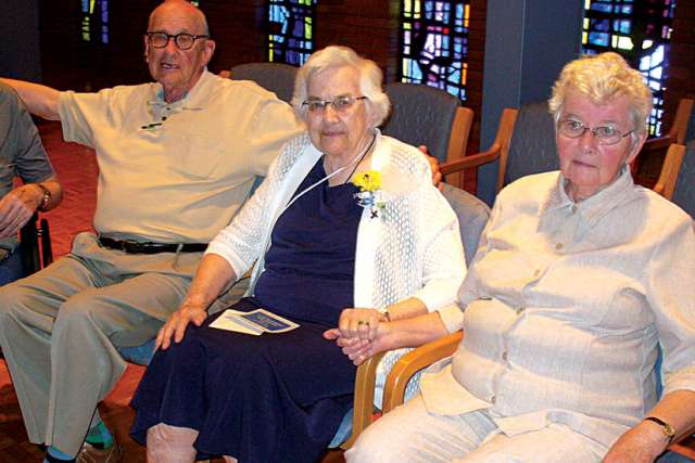 Sr. Aileen Gleason, centre, was honoured by Winnipeg community of the Sisters of Our Lady of the Missions.