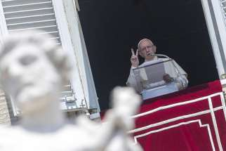 Pope Francis gestures as he leads the Angelus from the window of his studio overlooking St. Peter's Square July 29 at the Vatican.