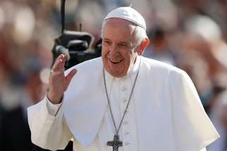 Pope Francis greets the crowd during his general audience in St. Peter's Square at the Vatican Nov. 7.
