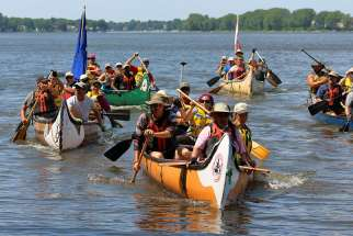 Jesuit and Indigenous pilgrims arrive by canoe Aug. 15 in Kahnawake, a First Nations reserve south of Montreal. It was the group's final destination after traveling 850 km, following a route used by 17th-century missionaries, in an effort to promote reconciliation.