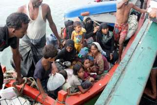 Refugees from Myanmar and Bangladesh are seen in their boat before their rescue by fisherman in Julok, Indonesia, May 20.