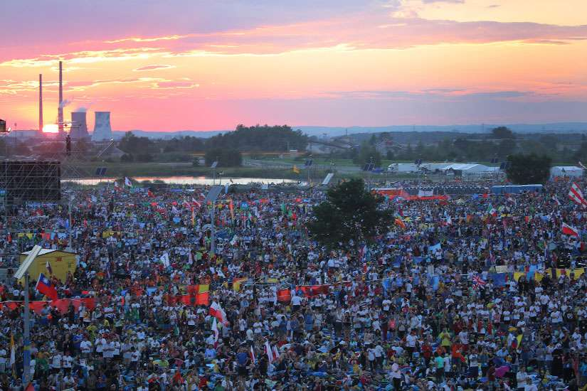 The sun sets over World Youth Day pilgrims as Pope Francis attends a July 30 prayer vigil at the Field of Mercy in Krakow, Poland.