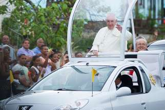 Pope Francis waves to crowd near Havana's apostolic nunciature after his Sept. 19 arrival in Cuba.