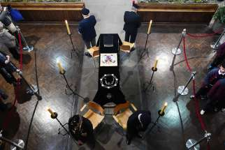 Guards surround the coffin of King Richard III as his remains lie in repose at Leicester Cathedral during the public viewing of his coffin in Leicester, England, March 23.