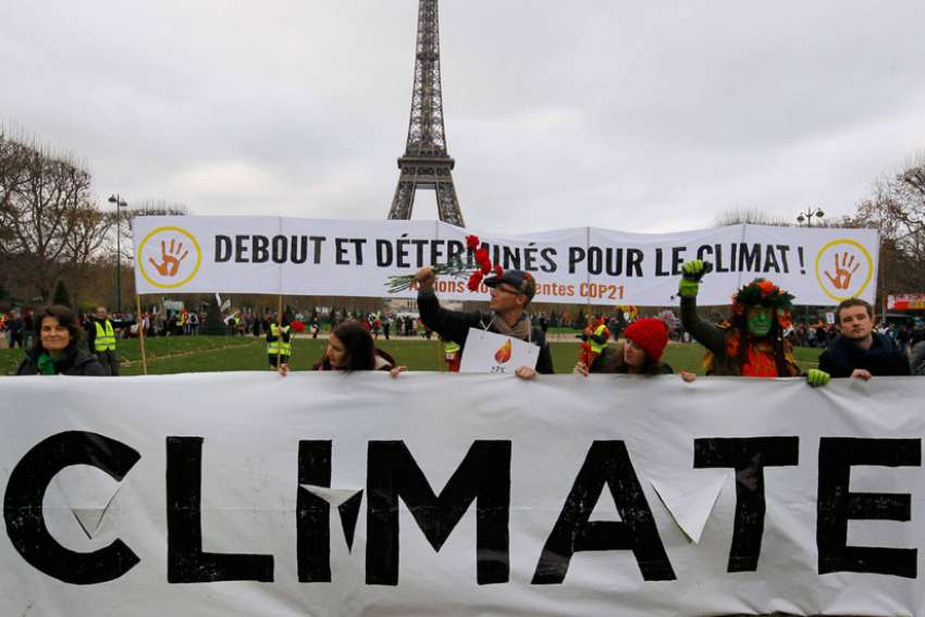 Environmentalists protest near the Eiffel Tower in Paris as the U.N. climate conference ended Dec. 12, 2015.