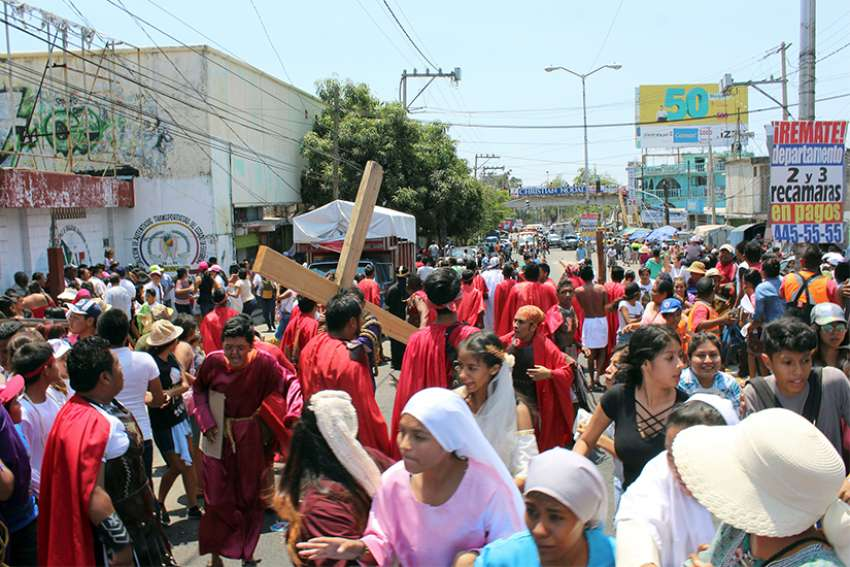 People react as others run for cover after a shooting near a Via Crucis procession in Acapulco, Mexico, March 30.