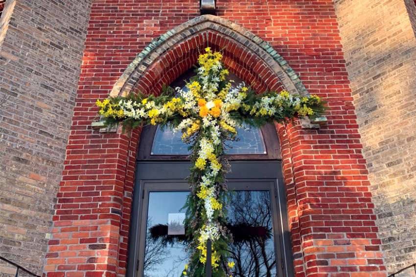 Michael Madden, a parishioner at St. Mary Immaculate Church in Elora, Ont., made sure the Easter season was celebrated at church despite the pandemic. He constructed a cross that was erected on the fifth Sunday of Lent and painted purple, then red for Palm Sunday, and finally decorated with flowers for Easter Sunday.