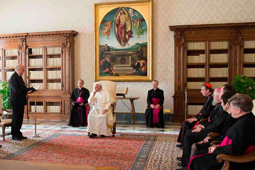 Pope Francis attends a special audience with members of the German Evangelical-Lutheran Church at the Vatican Dec. 18, 2014.