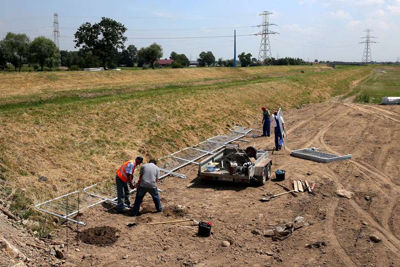 Workers install security barriers at the site of Campus Misericordiae in Brzegi, Poland June 15.