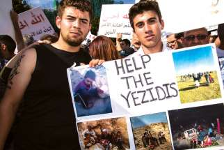 Facing a genocide at home in Iraq, these Yazidi men were eager to protest with Iraqi Christians in Toronto.