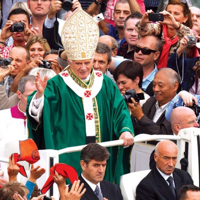 Pope Benedict XVI greets the crowd after celebrating the opening Mass of the Synod of Bishops on the new evangelization in St. Peter's Square at the Vatican Oct. 7.