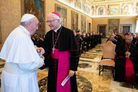 Pope Francis greets Archbishop Piero Marino, president of the Pontifical Committee for International Eucharistic Congresses, during an audience with members of the committee at the Vatican Nov. 10. The next Eucharistic Congress will be held Sept. 13-20, 2020, in Budapest, Hungary.