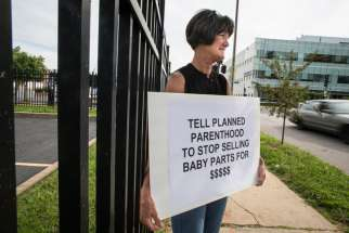 Bev Ehlen, state director of Concerned Women for America, holds a sign outside of a Planned Parenthood facility in St. Louis July 21. She was among several pro-life supporters demonstrating after the release of two videos that showed Planned Parenthood o fficials discussing the method and price of providing fetal tissue obtained from abortions for medical research.