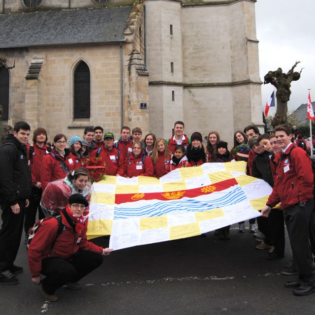 Using Barrie's flag as the centrepiece, students from the Ontario city's St. Joseph's High School filled each surrounding square with their research on Vimy Ridge and then carried the banner during the silent march to the Vimy Ridge Monument in France  on April 9.