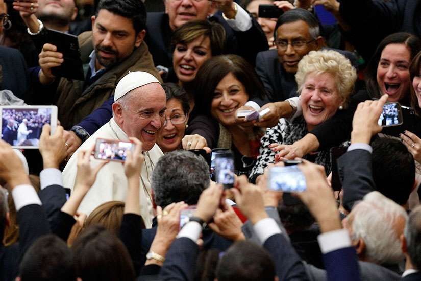 Pope Francis said he would attend the World Meeting of Families in Philadelphia in September 2015, making it the first confirmed stop on what is expected to be a more extensive papal visit to North America.