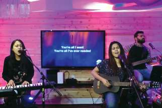 The band iv24 is creating spiritual communion during the COVID-19 crisis by hosting virtual prayer and worship sessions on Facebook every Friday night. From left are Desiree D'Cunha, Whitney D'Cunha and Rudy D'Souza.