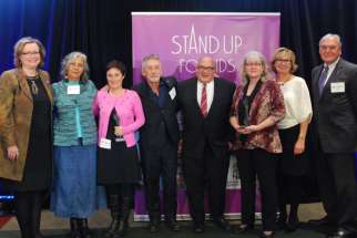 Cindy Stirling, third from right, was recipient of the Stand Up for Kids Award for her 27 years as a foster parent, the last six with Catholic Children's Aid Society of Toronto.
