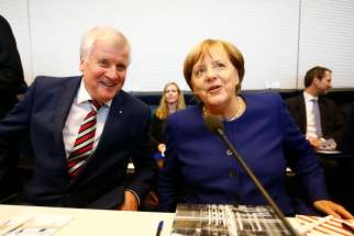 German political leaders Horst Seehofer and Chancellor Angela Merkel attend their first parliamentary meeting after the general election in Berlin.