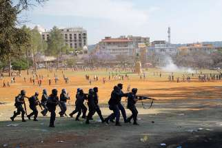 Police forces clash with protesters at the Union Buildings in Pretoria, South Africa, in this Oct. 23, 2015, file photo.