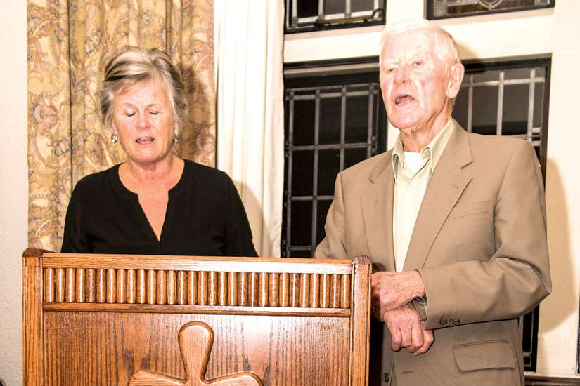 Barb and Mike McManus speak from behind the ambo that was presented to them upon their retirement from the National Catholic Broadcasting Council Nov. 11. The ambo will remain in the chapel of Loretto Abbey where the Daily Mass is broadcast from.
