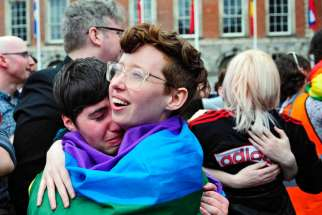 People embrace as the final vote of the referendum on same-sex marriage is announced May 23 in Dublin. Archbishop Eamon Martin of Armagh, Northern Ireland, president of the Irish bishops' conference, says the church must do more to reach out to gay people.