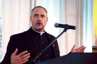 Fr. Chris Lemieux addesses the Ordinandi Dinner in Toronto earlier this month when 13 men about to enter the priesthood were introduced.
