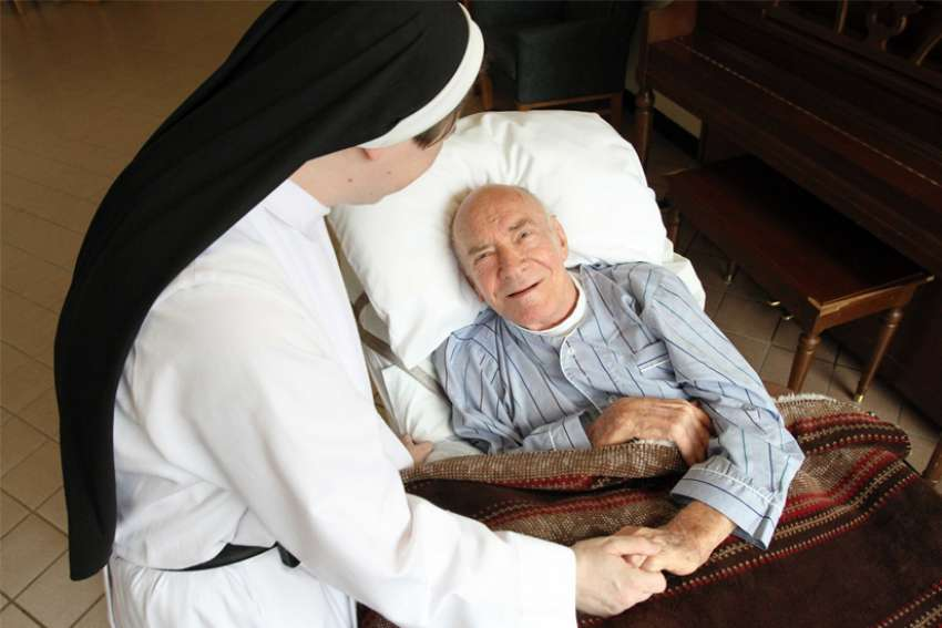 A patient is pictured in a file photo chatting with a nun at Rosary Hill Home, a Dominican-run facility in Hawthorne, N.Y., that provides palliative care to people with incurable cancer and have financial need.