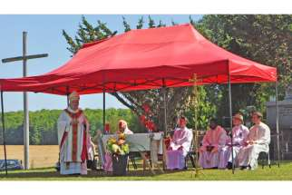 Cardinal Thomas Collins, archbishop of Toronto, celebrated a special liturgy Aug. 15 commemorating the 400th anniversary of the first Catholic Mass in Ontario near present-day Lafontaine. The open-air event attracted hundreds of residents from across Ontario to southern Georgian Bay.