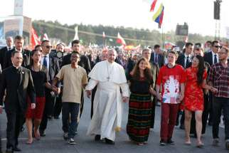 Pope Francis walks with World Youth Day pilgrims as he arrives for a July 30 prayer vigil at the Field of Mercy in Krakow, Poland. Nigerian pilgrims hope their experience at World Youth Day 2016 will help affect change with challenges back home.