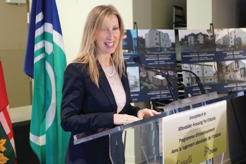 Suzanne Le, executive director of Multifaith Housing Inititatives, speaks last month at a funding announcement by all three levels of government for affordable housing.