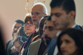 Hundreds gathered in Toronto Jan. 14 for a Mass to mark the World Day of Migrants and Refugees. They heard Toronto Auxiliary Bishop Wayne Kirkpatrick, top left, praise the growing relationship between Catholics and refugees in the archdiocese.