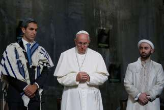 "Pope Francis stands between Jewish and Muslim religious leaders during a prayer service at the ground zero 9/11 Memorial Museum in New York Sept. 25. Father John W. Crossin, executive director of the Secretariat for Ecumenical and Interreligious Affairs of the U.S. Conference of Catholic Bishops said, ""This event is symbolic and is iconic. It's a healing message."""