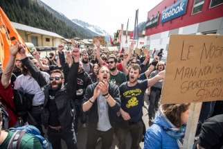 People demonstrate April 3 against the Austrian government's planned reintroduction of border controls at the Brenner Pass in Austria. Austrian church leaders have criticized their government for rebuilding border controls in a bid to keep out refugees arriving from Greece and Italy.