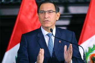 Peruvian President Martin Vizcarra is seen July 11 in the Tupac Amaru hall of the Government Palace in Lima. Vizcarra announced the creation of a commission to propose a reform of the judicial system and said he will present the proposal to Congress during his state of the nation message July 28, Peru's independence day.