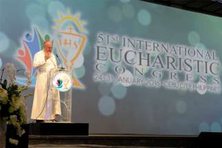 Cardinal Timothy M. Dolan of New York speaks in 2016 at a session of the 51st International Eucharistic Congress in Cebu, Philippines. Pope Francis, the Pontifical Committee for International Eucharistic Congresses and local organizers have agreed to postpone by one year the 52nd International Eucharistic Congress in Hungary, the Vatican announced April 23, 2020.