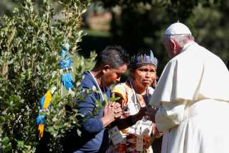 Pope Francis greets members of an indigenous community of the Amazon during a celebration marking the feast of St. Francis in the Vatican Gardens Oct. 4, 2019.
