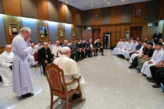 Pope Francis meets with Jesuits in Tha Kham, Thailand, Nov. 22, 2019, during his apostolic trip to the Asian country. In his customary question-and-answer session with his Jesuit confreres, Pope Francis spoke about resistance to addressing climate change and about hostility to migrants and refugees.