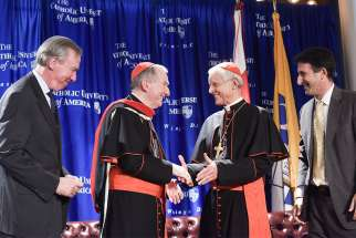 Vatican secretary of state, Cardinal Pietro Parolin, centre, is congratulated by John Garvey, president of The Catholic University of America, Washington Cardinal Donald W. Wuerl, and Andrew Abela, the university's provost, after receiving an honorary doctorate of theology Nov. 14, 2017, at the university.