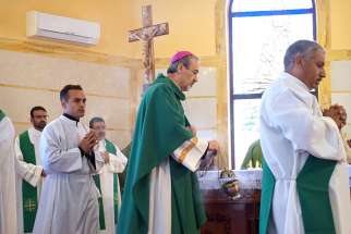 Archbishop Pierbattista Pizzaballa, apostolic administrator of the Latin Patriarchate of Jerusalem, celebrates Mass in Marj Al Haman, Jordan, July 23.