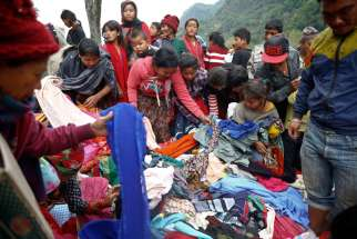 Earthquake survivors select clothes from a relief material delivery near Gorkha, Nepal, May 1.