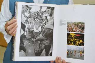 Sister Porferia Ocariza, a member of the Daughters of St. Paul, holds a book on the People Power uprising in the Philippines 30 years ago to oust dictator Ferdinand Marcos. She is still recognized today for her stunned expression, left image, as military tanks approached.