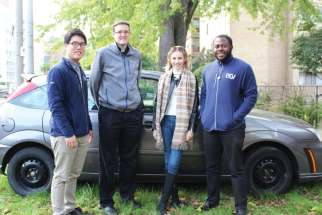 OCY missionaries with their new Ford Focus, donated by Fr. Scott Burchill outside of Serra House. From left, Francis Yoo, Burchill, Veronica Stach and Andre Tyson.