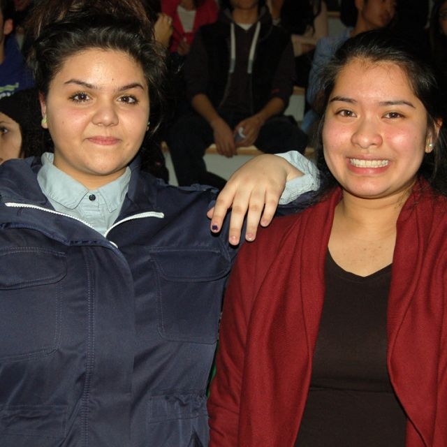 Catarina Arezes, left, and Erica Sadri collaborated on a spoken word piece they performed at the Give Peace a Dance event March 7 to promote awareness about violence against youth.